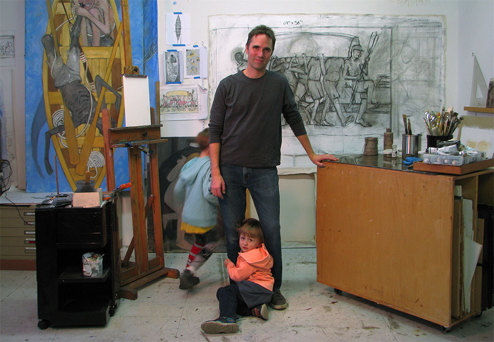 Eric and his two sons in the studio